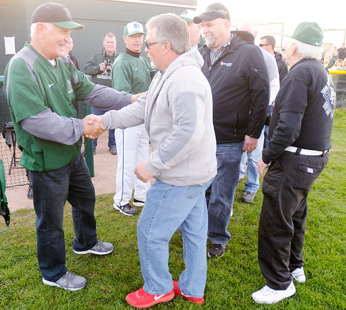 Former Pendleton Heights baseball coach Bill Stoudt greets former players who returned to see the Arabians baseball field named for coach Stoudt on Friday. To purchase this photo or other photos produced by The Herald Bulletin staff, visit heraldbulletin.smugmug.com.