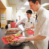 Missionaries Troy Gajdos and Jacob Bighorse serve up lunch at the Christian Center.