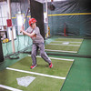 Colin Coryell, 14, practices at Dingers Batting Cages in Anderson. The indoor facility has one softball and two baseball batting cages. To purchase this photo or other photos produced by The Herald Bulletin<br /> staff, visit heraldbulletin.smugmug.com.