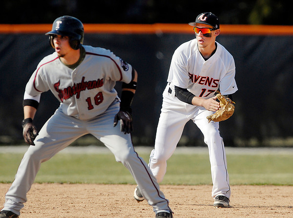 AU's shortstop Andrew Eiler creeps up behind Transylvania's base runner Pete Travisano to help keep him close to second base during their game Friday.