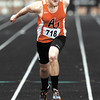 AU's Nick Moyer stretches out as he crosses the finish line in his heat of the men's 200 meter dash during the AU Invitational Track & Field meet.
