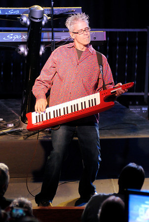 "Chris Marion plays a keytar as the Little River Band performs the song ""Happy Anniversary"" in concert at Hoosier Park on Friday."
