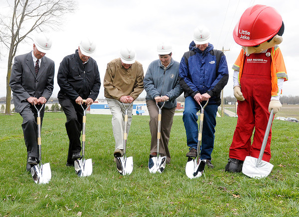 From left, Joe Buck, Mike Latchaw, Don Henderson, Brandye Hendrickson, Jerry Bridges and E&B mascot Little Joe break ground for a traffic circle to be installed in the intersection of Indiana 38 and County Road 300 West.