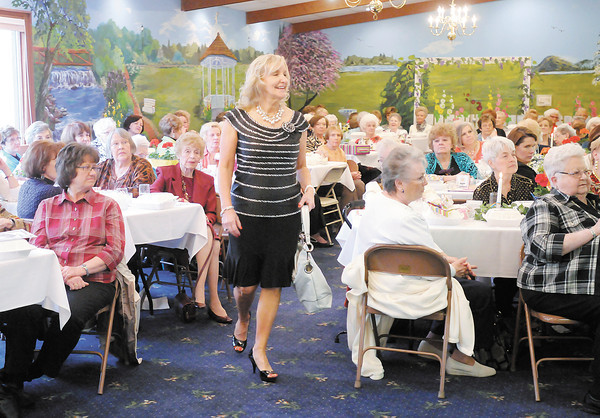 Sharron McNabney models an outfit from the Victoria Guild gift shop at St.Vincent Anderson Regional Hospital during the Isabel Society Box Lunch and Style Show at the Harter House on Wednesday. The event is an annual fundraiser for United Faith Housing.