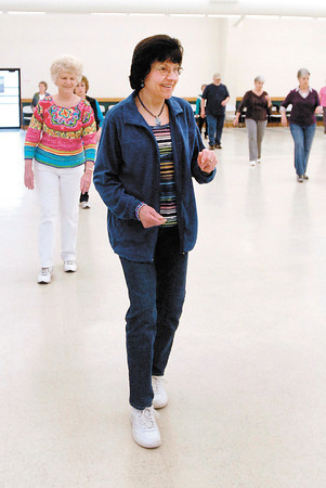 Ruby Closser, of Alexandria, is all smiles as she goes through the steps of a new line dance she and the others are learning.