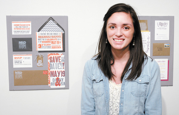 """Melissa Stritch stands next to her letterpress """"Melissa & Danny"""" that is hanging in the Anderson University student art exhibit."""