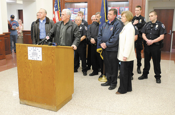 Governor Mike Pence, US Representative Susan Brooks and Indiana Homeland Security Executive Director John Hill held a press conference in Elwood after touring flood damage in Kokomo, Tipton and Elwood on Saturday.