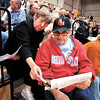 Cindy Spears, of Yorktown, helps Vearl Beckham, of Anderson, get his bearings as she points out some Delaware County landmarks on the Mounds Lake map before the public meeting on the reservoir at Daleville High School Tuesday evening.