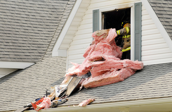 Fire fighters from Adams Township and Pendleton overhaul a house fire at County Road 4991 E 800 S on Wednesday afternoon.