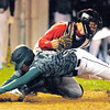 Pendleton Heights' Thomas Hall slides into Anderson's Jake Fox to score a run during the Nick Muller Memorial Baseball Tournament final at Memorial Field on Saturday.
