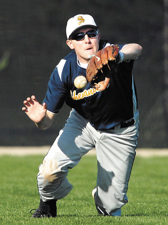Shenandoah's center fielder Trevor Conner loses the ball off his mitt as he tried to make a running catch in the 5th inning of their game with Pendleton.  Conner was charged with an error that started a 5-run inning for Pendleton.