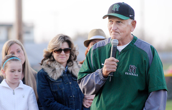 Former Pendleton Heights coach Bill Stoudt speaks as his family stands nearby during a ceremony naming the Arabians' baseball diamond after coach Stoudt on Friday. To purchase this photo or other photos produced by The Herald Bulletin staff, visit heraldbulletin.smugmug.com.