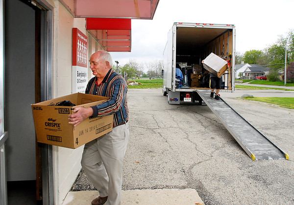 Habitat for Humanity executive director Karl Graddy carries a box into their new facility at 800 East 19th Street in Anderson Monday afternoon.