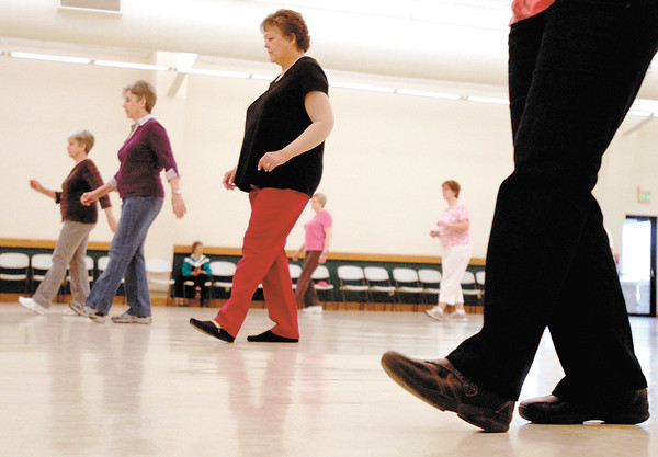 About 30 people get together every Monday at the 4-H Community Building in Alexandria's Beulah Park to learn line dancing.