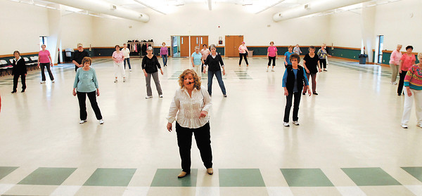 Dance instructor Marilyn Goldman leads about 30 people every Monday in line dancing at the 4-H Community Building in Alexandria's Beulah Park.