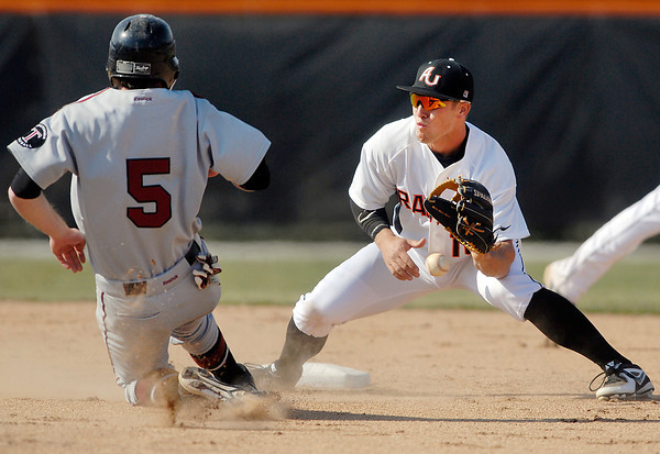AU's 2nd baseman Austin Young waits for the ball as Transylvania's  Nick Edwards starts his slide into second on a stolen base attempt in the 3rd inning.  <br /> The ball got away from Young so the runner was safe.