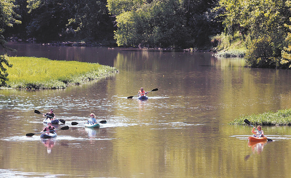 Kayakers depart from Edgewater Park during the White River Watchers River Celebration on Saturday. The USGS reported the river level of 4.27 feet at Edgewater Park at noon on Saturday.