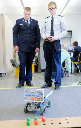 At right team captain William Stephens gives some driving tips to Forest Gray as the APA Robotics team met after school on Tuesday.