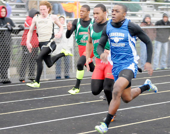 APA's Tyler Smith Johnson wins the 100 meter dash during the Madison County Track Tournament at Madison-Grant on Friday.