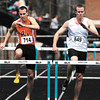 AU's Brad McNeil and unattached competitor Robby Burns are stride-for-stride going to the last hurtle of the men's 400 meter race during the AU Invitational Track & Field meet Saturday.  McNeil finished 2nd and Burns finished 3rd in the race.