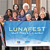 Soroptimist International of Anderson members assemble on the steps of The Anderson Center for the Arts to display their banner for LUNAFEST film festival, which will take place at the Center on April 13, 2013.