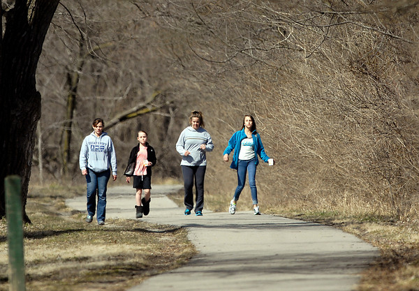 Amy Smith, daughter Kenzy Smith, 9, family friend Lea Thompson, and daughter Kalista Smith, 13, take advantage of the warmer, sunny weather to get outside and take along walk around Shadyside Lake Wednesday afternoon.