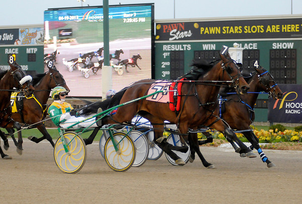 Trace Tetrick drives Aqua Artist to win the Fillies and Mares Invitational Pace at Hoosier Park on Friday.