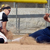 AU's 3rd baseman blocks the bag and puts the tag on the leg of St. Mary's Jillian Busfield as she slides into the bag in the 6th inning of the first game of their doubleheader Thursday.  Busfield was out on the play to end the inning.