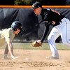 Manchester's  Trevor Kimm gets back to second base as AU's shortstop Andrew Eiler tries to tag him out on a pickoff attempt in the third inning of their baseball game Tuesday.