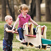 3 year old Bradley Burgan gives Audrey Marion, 5, some help by pushing her on the teeter-totter at Shadyside Lake playground Tuesday.  They were out with family enjoying the nice weather and met on the playground.