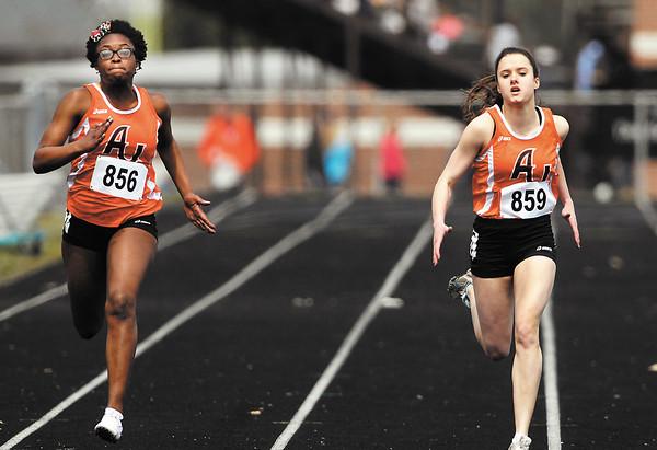 AU's Deborah Gardner, and Rachel Grubbs were neck & neck at the wire of their 200 meter dash heat race during the AU Invitational Track & Field meet Saturday.   Grubbs finished 2nd and Gardner finished 3rd overall in the event<br /> <br /> <br /> <br /> <br /> AU Invitational Track & Field meet