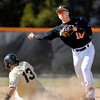 AU's second baseman Austin Young throws to first in a double play attempt against Manchester University Tuesday.  Manchester's #13 Cody Schell was out at second but the batter was safe at first.