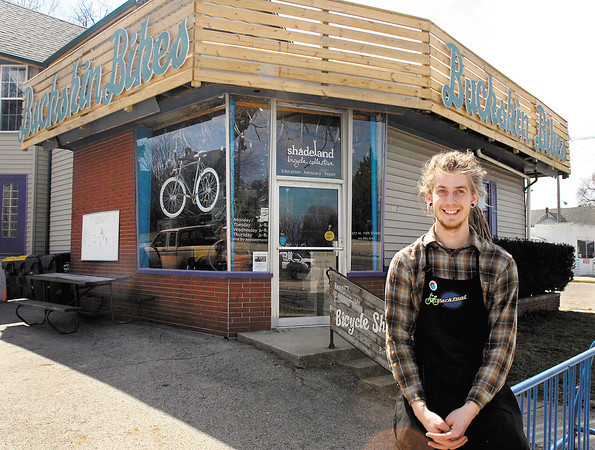 Buckskin Bikes, with owner Ben Orcutt, in front of his shop at 517 W. 11th St. in Anderson.