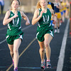 Sisters Monica, left, and Anna Dudley run first and second in the 800 meter run for Pendleton Heights during the Arabians' Girls Track Invitational on Thursday. To purchase this photo or other photos produced by The Herald Bulletin staff, visit heraldbulletin.smugmug.com.