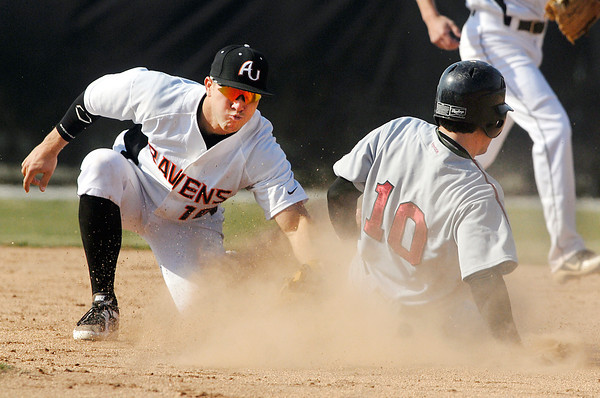 AU's Austin Young puts the tag to Transylvania's  Graham Winchester to tag him out as he attempted to steal second base in the 4th inning of their game Friday.