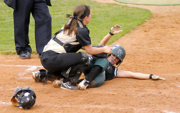 Pendleton Heights' Sydney Windlan scores beating the tag of Madison Grant catcher Kayla Martin in the second round of the County Softball Tournament at Pendleton on Wednesday.