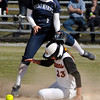 St. Mary's shortstop Emily Sherwood hops over AU's sliding Sam Steele after she stole 2nd base in the 6th inning of their first game Thursday.