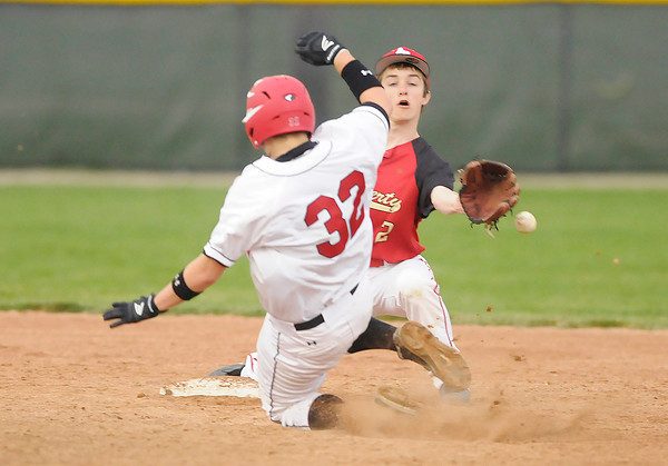 Frankton's Matt Kunce steals second beating the throw to Liberty Christian's Dalton Miller in the second round of the Nick Muller Memorial Baseball Tournament at Pendleton on Wednesday.
