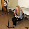"Pendleton Heights' sophomore Emily Callen performs her original song ""20 Angels"" as Aspire held a candle light vigil on Tuesday as part of child abuse awareness month. Callen was inspired to write her song in the wake of the Newtown Connecticut shootings."