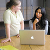 Amrutha Pulikottil helps Destiny Cox pick one of her photos for a blog post.