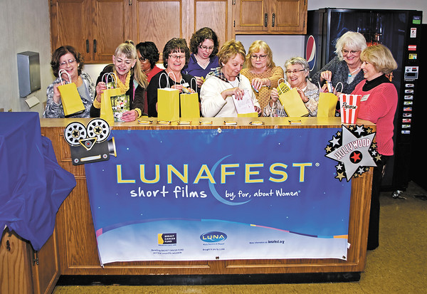 Soroptimist International of Anderson members fill gift bags for attendees of LUNAFEST film festival, which will take place at The Anderson Center for the Arts on April 13, 2013.