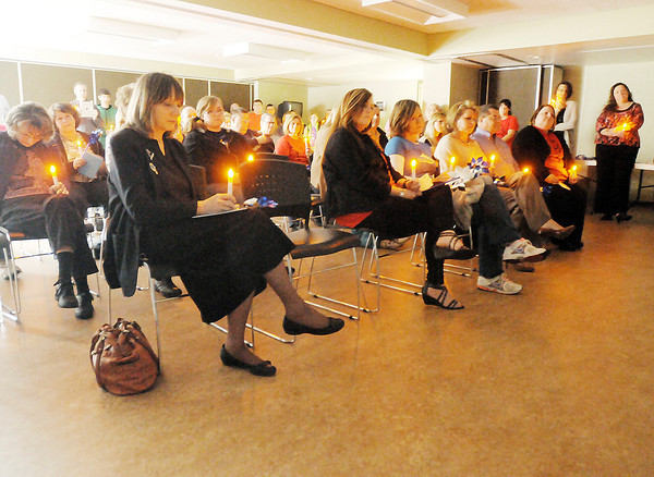 Aspire held a candle light vigil on Tuesday as part of child abuse awareness month.