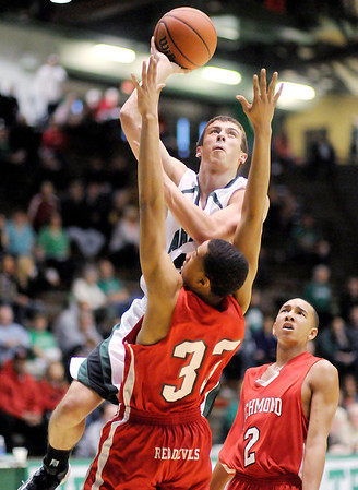 Pendleton Heights' Brogan Gary drives to the basket over Richmond defender  Abdul Shabazz on Friday.