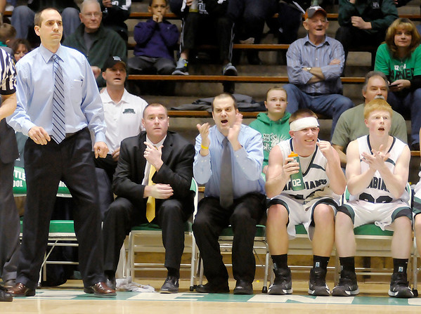 The Pendleton Heights bench reacts as the Arabians hold of a run by the Richmond Red Devils in the second half.