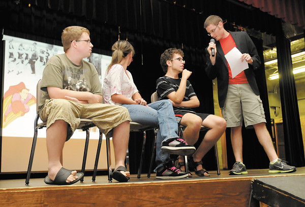 Anderson High School students take part in a game where there parents try to guess their answers to questions during an orientation meeting for freshman and sophomores on Tuesday.