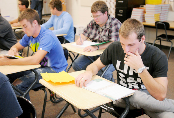 Lapel senior Derrick Dubuque looks through his school planner on the first day of school at Lapel High School on Wednesday.