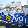 Retired union members protest in front of the Pay Less on 29th Street on Wednesday. A group of delegates delivered a letter to the management of the store.