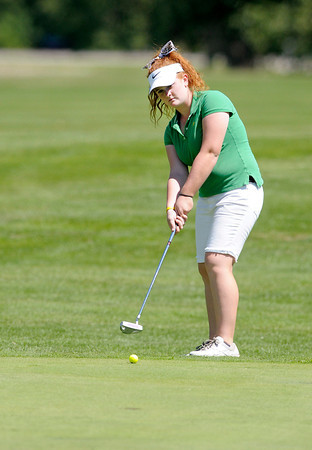 Anderson's Morgan Wiley putts on the 18th green during the County Golf Tournament at the Cattails Golf Club in Elwood on Saturday.