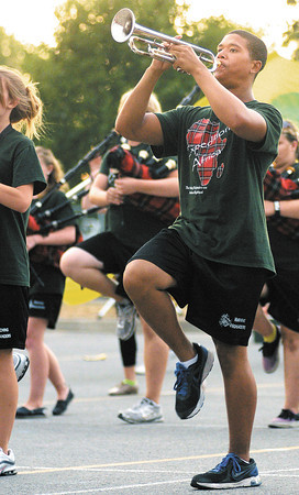 """Anderson High School junior Demetrius Peoples, 16, performs with the Marching Highlanders as they perform their show, """"Expdition Africa,"""" for parents on Tuesday."""