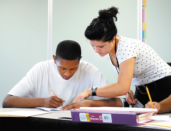 Math teacher Miriam Henry assists Tyler Hudson in her Algebra 2 class on the first day of classes at the Excel Center.